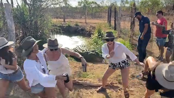 "Watch These Tourists Run in Fright as Crocodile ""Snaps"" During Group Photo (VIDEO)"