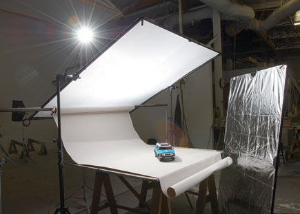 The Lighting Setup For Car Photo Frame Holding Overhead Silk Is Supported On Sides With Scrim Jim Clamps In Grip Heads Attached