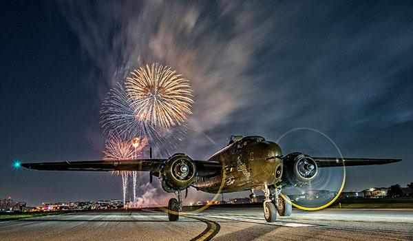 How Photographer Gary Daniels Shot A WWII Aircraft Bomber At Night During Fireworks Show